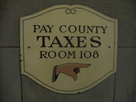 Historic Pay County Taxes sign